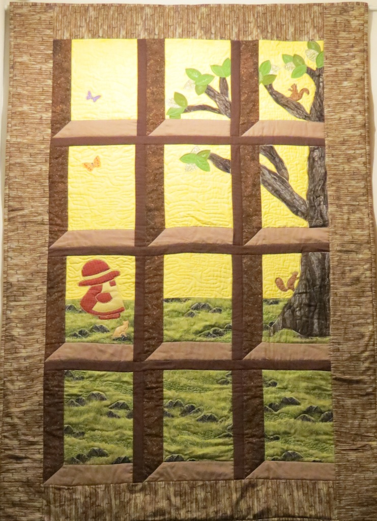 attic window quilt with machine applique sun bonnet girl